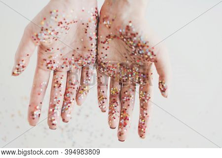 Female's Hands Covered With Shiny Glitters On White Background. Creativity, Hope, Joy, Kindness Or H