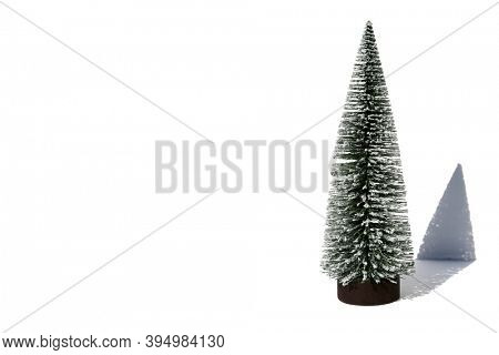 Christmas Tree. A Christmas Tree with a shadow. Isolated on bright white. Room for text or images. Clipping Path. Christmas is the season for fun. Merry Christmas.