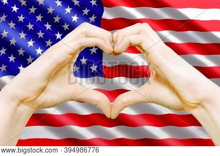 Composite Image Of American Patriotic Love Symbol - Female Hands Makes Heart Sign On The Background