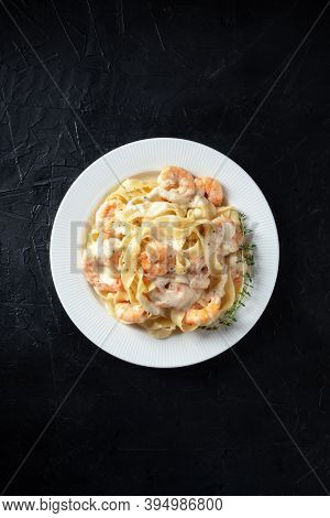Italian Pasta. Pappardelle With Shrimps And Creamy Sauce, Shot From Above With Thyme And A Place For