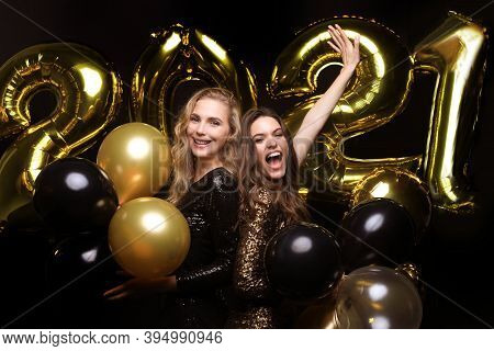 Happy Gorgeous Girls In Stylish Sexy Party Dresses Holding Gold 2021 Balloons, Having Fun At New Yea