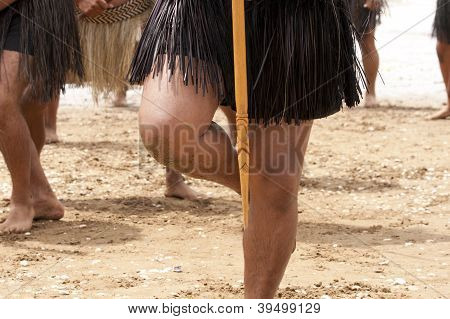 Legs Of A Maori Warrior On The Beach Of New Zealand