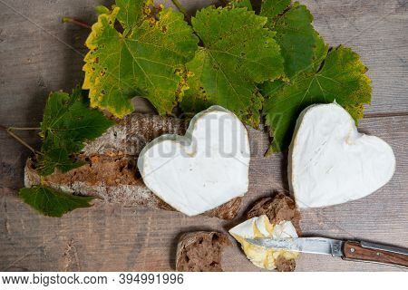 French Neufchatel Cheese Shaped Heart On The Autumn Leaves