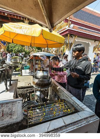 Bangkok, Thailand - December 7, 2019: People Paying Respect With Incense Sticks On Joss-stick Pot In