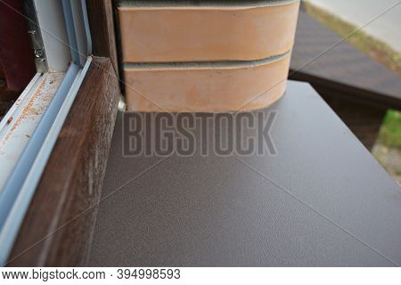 A Close-up On Upvc Plastic Window Installation White Inside And Brown Outside With A Window Frame An