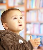 Portrait Of Baby Boy Wearing Warm Clothing at a library poster