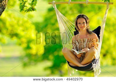 beautiful young woman swinging outdoor