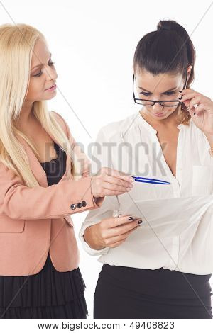 Two beautiful caucasian businesswomen on white isolated background