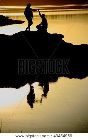 Man Making Marriage Proposal At Sunset