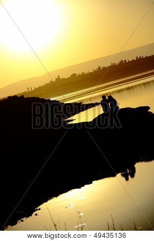 Romantic Couple At Sunset