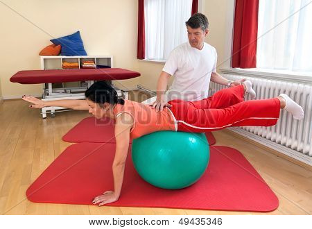 Adult Practicing Poses On Exercise Ball