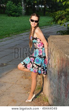 The Beautiful Young Woman Costs On  Avenue In Summer  Park