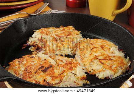 Potato Latkes In A Cast Iron Skillet