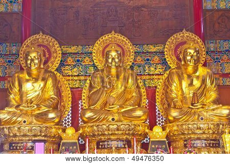 Chinese god golden statue from Chinese temple can be use for various chinese god related concepts. poster