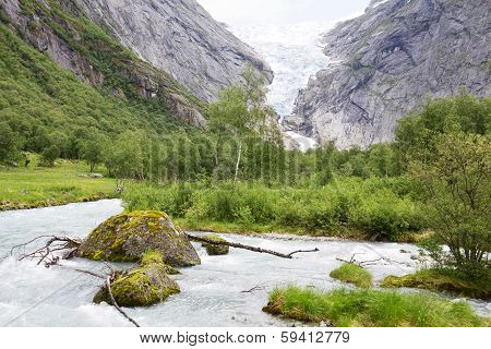 The Mountain Landscape With The Briksdal Glacier In Norway