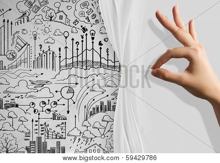Close up of hand opening the white curtain with business sketches behind