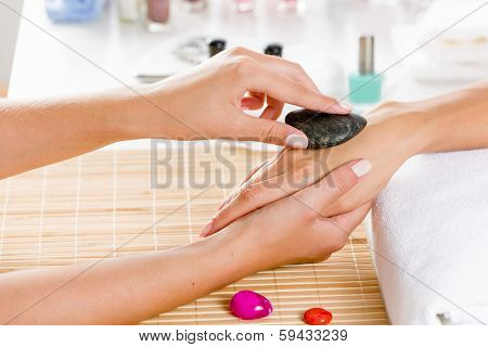 Close up of process of hand massage at beauty salon