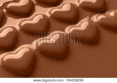 Photo of chocolate hearts covered in creamy milk chocolate shot at an angle with copy space for your own message.