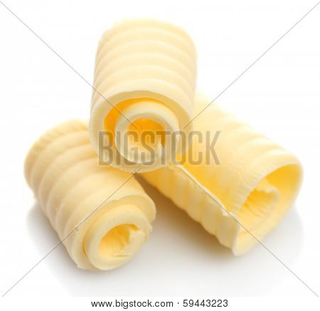 Curls of fresh butter, isolated on white poster