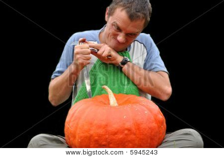 Young Guy Eating A Pumpkin