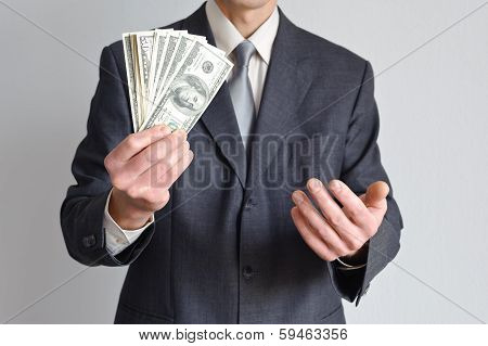 Man In A Suit Shows Money
