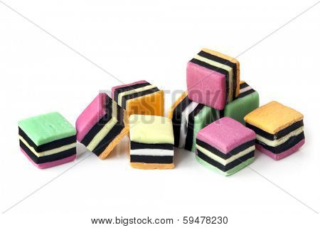 Liquorice allsorts over a white background.