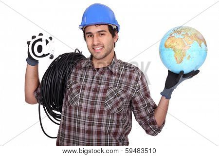 Electrician holding globe and at symbol
