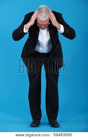 Businessman staring at the ground