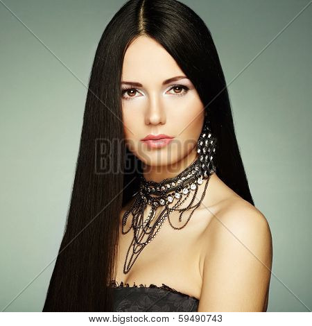 Portrait of young beautiful woman with jewelry. Beauty photo poster