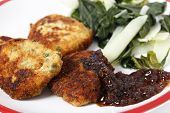 Homemade fishcakes and onion marmalade serves with boiled greens poster
