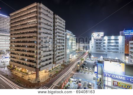 NAHA, JAPAN - NOVEMBER 12, 2014: Apartments and shops in downtown Naha, Okinawa. The city is the most populous in Okinawa.