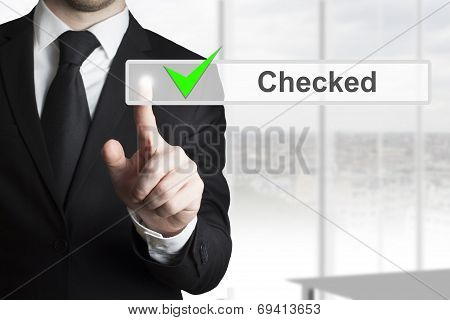 Businessman Pushing Touchscreen Checked