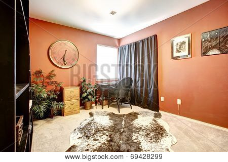 Orange Office Room With Cow Skin Rug