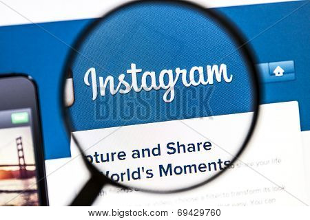 Ostersund, Sweden - August 3, 2014: Close up of instagram website under a magnifying glass. Instagram is an online mobile photo-sharing, video-sharing and social networking service.