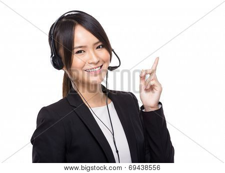 Businesswoman with headset with finger up