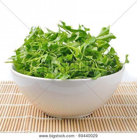 Watercress In Bowl On Bamboo