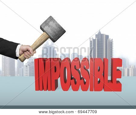 Hand Holding Hammer To Creak Impossible 3D Word