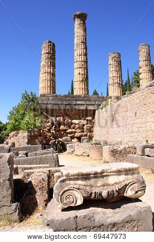 Ancient column and ruins of Temple of Apollo in the archaeological site of Delphi, Greece