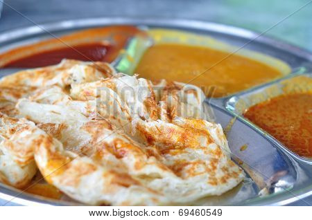 Roti canai flat bread Indian food made from wheat flour dough. Famous malaysian dish Roti canai and curry. poster
