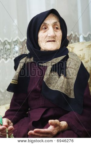 Elderly Woman With Beads