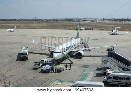 VALENCIA, SPAIN - AUGUST 2, 2014: A Ryanair aircraft getting ready for departure from the Valencia Airport. Ryanair is the biggest low-cost airline company in the world.