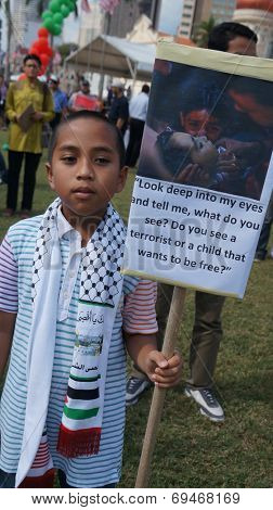 Kuala Lumpur, Malaysia - August, 2: Unidentified Malaysian children holds sign protesting Israeli military strikes on Gaza, during the pro-Palestine rally in Kuala Lumpur, August 2, 2014.