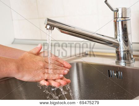 Woman Washing Hands Under A Tap Water