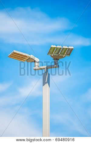 LED street lamps post on blue sky background poster