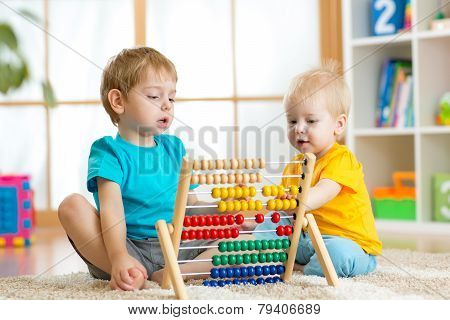 kids playing with abacus