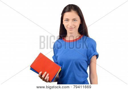 Beautiful student in blue blouse holding books.