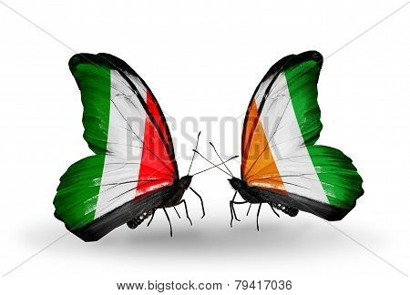 Two Butterflies With Flags On Wings As Symbol Of Relations Italy And Cote Divoire