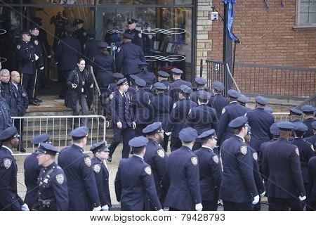 84th Precinct officers enter mortuary