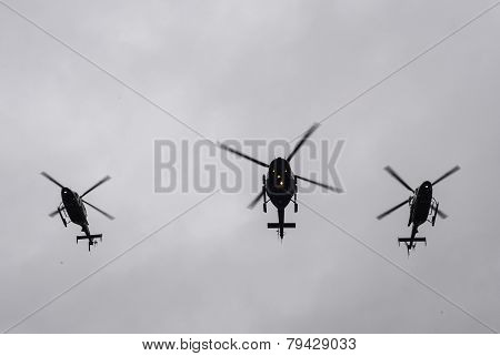 NYPD helicopters fly over in formation