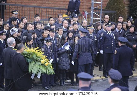 Pei Xia Chen with folded NYPD flag